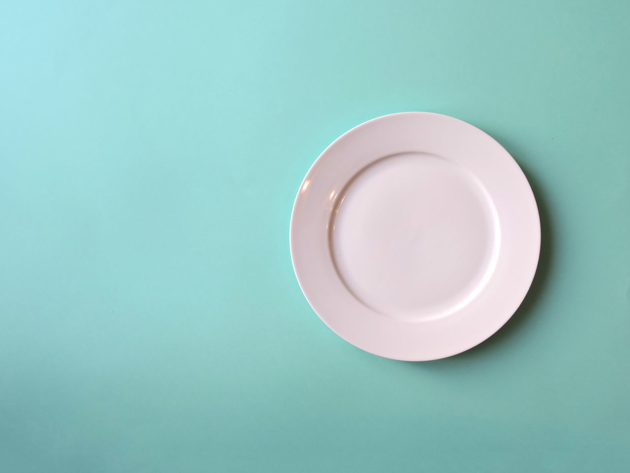 Above View Blue Background Cutlery Dinner Plate Fork Knife Minimal Plate Studio White Plate
