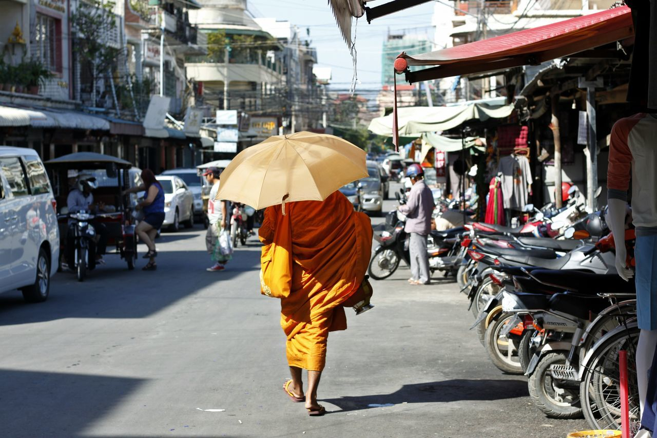 Adult Architecture Bhudism Bhudist Monk Bhudist Monk Walking On The Strret Building Exterior Built Structure Full Length Land Vehicle Manual Worker Men Occupation One Man Only One Person Only Men Outdoors Over-burdened People Real People Rear View Religion Repairing Road Work Tool Working