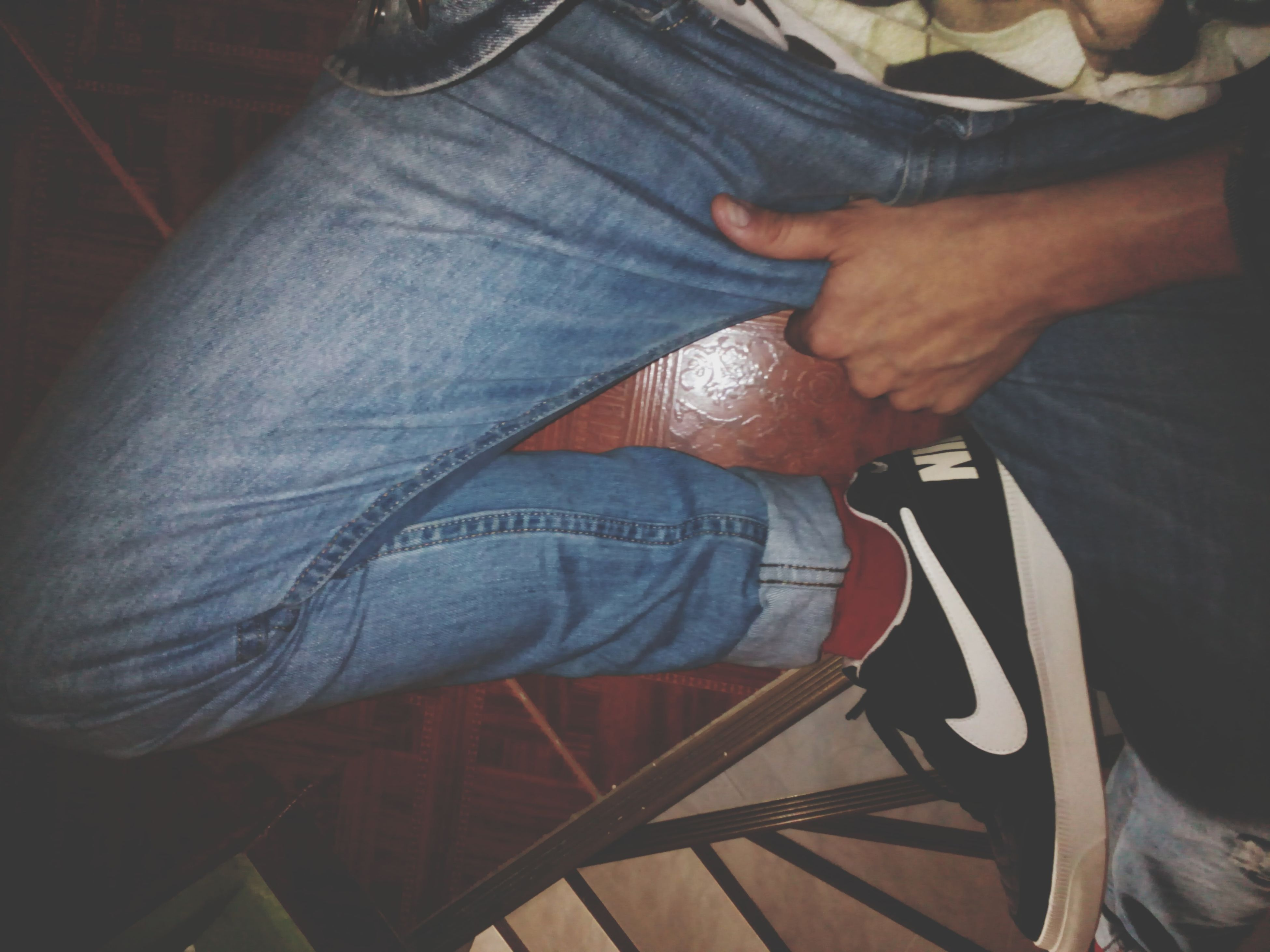 lifestyles, indoors, low section, person, men, leisure activity, wood - material, part of, standing, jeans, casual clothing, shoe, close-up, unrecognizable person, wooden