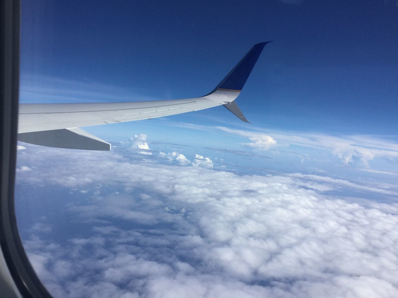 airplane, sky, transportation, airplane wing, journey, flying, nature, aerial view, travel, blue, cloud - sky, mode of transport, mid-air, cloudscape, aircraft wing, air vehicle, day, no people, beauty in nature, outdoors, scenics