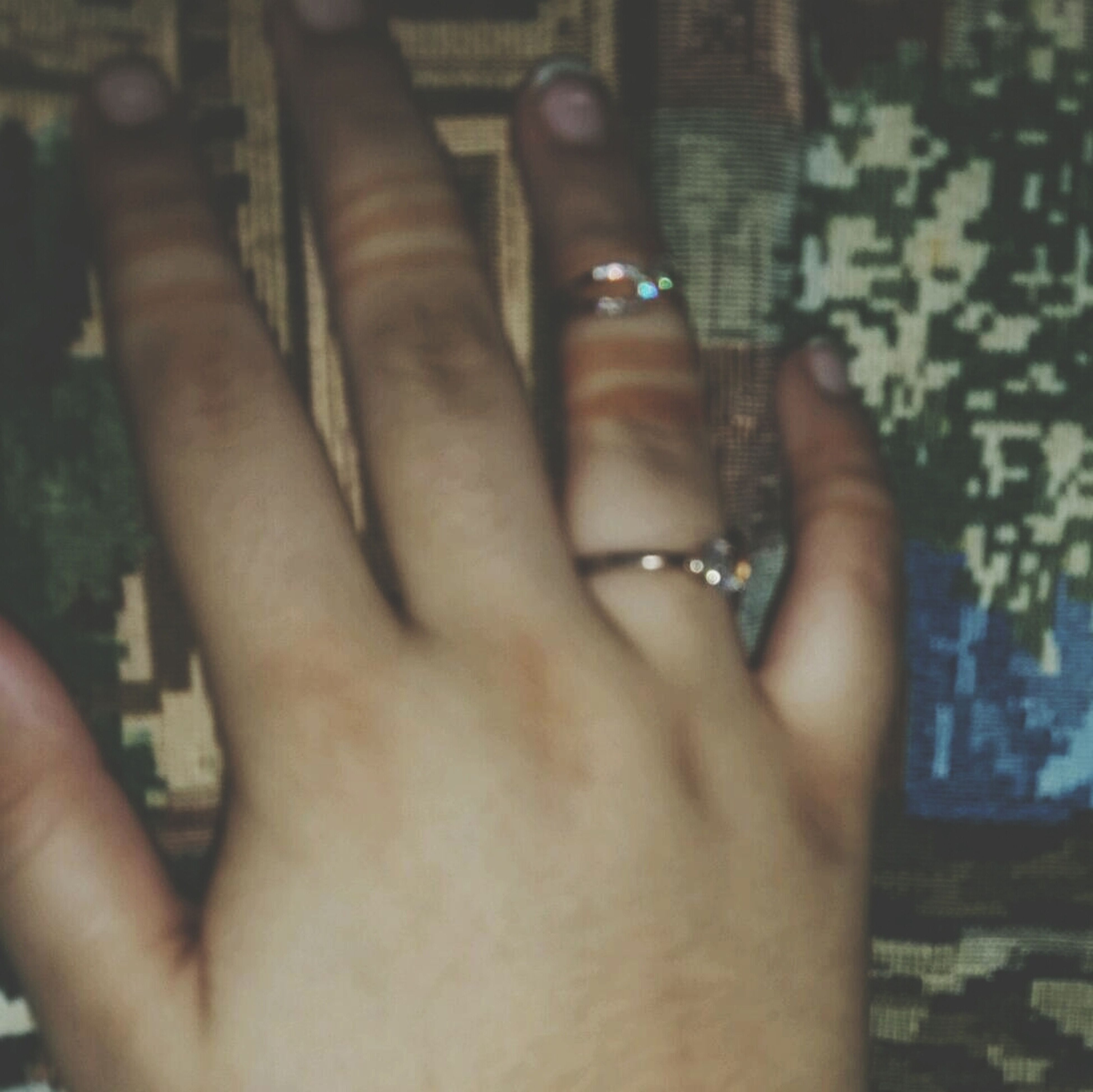 person, part of, human finger, lifestyles, cropped, close-up, holding, personal perspective, leisure activity, unrecognizable person, human skin, indoors, focus on foreground, ring, touching, palm