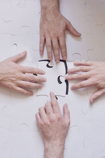 Human Hand Human Body Part Puzzle  Solution Togetherness Indoors  Holding Close-up Teamwork Men Real People Day People EyeEmNewHere EyeEm Selects