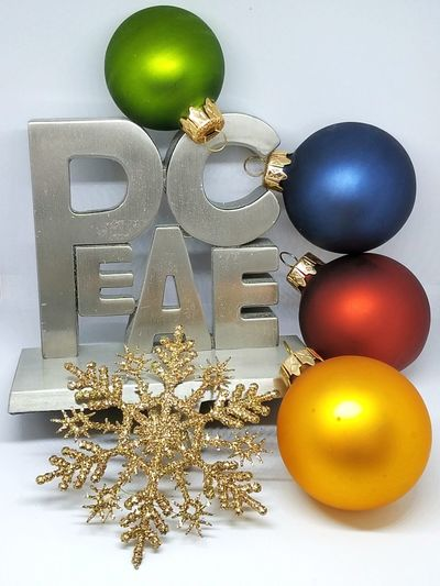 "Metal ""Peace"" sign with Christmas ornaments Peace Christmas Ornaments Red Blue Gold Green Studio Shot No People"