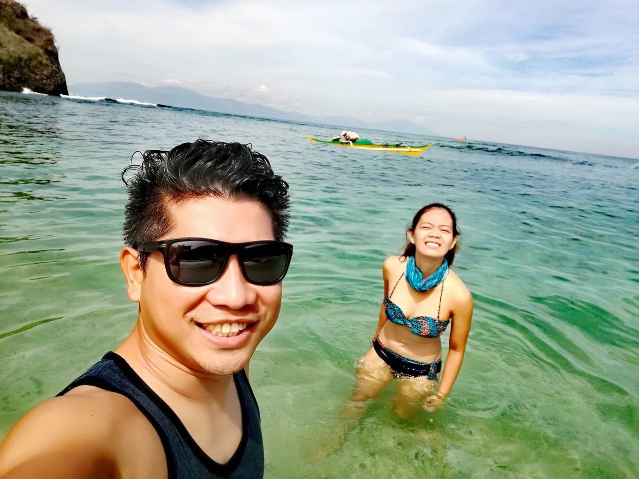 looking at camera, smiling, two people, real people, leisure activity, portrait, happiness, sea, lifestyles, young adult, water, young women, nature, outdoors, togetherness, beauty in nature, day, cheerful, enjoyment, sky, vacations, standing, weekend activities, adventure, scenics, bonding, friendship