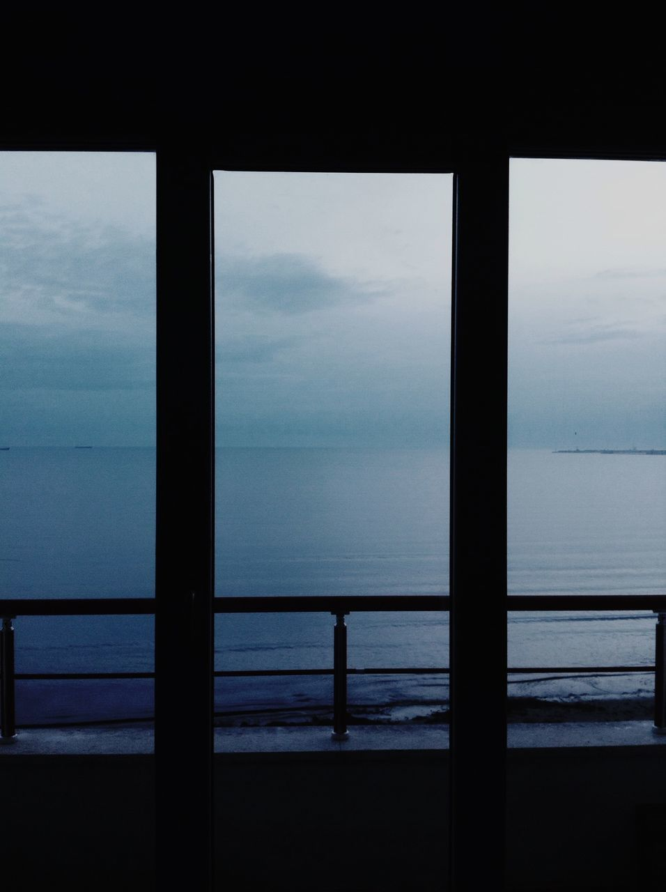 Calm Blue Sea Seen Through Window