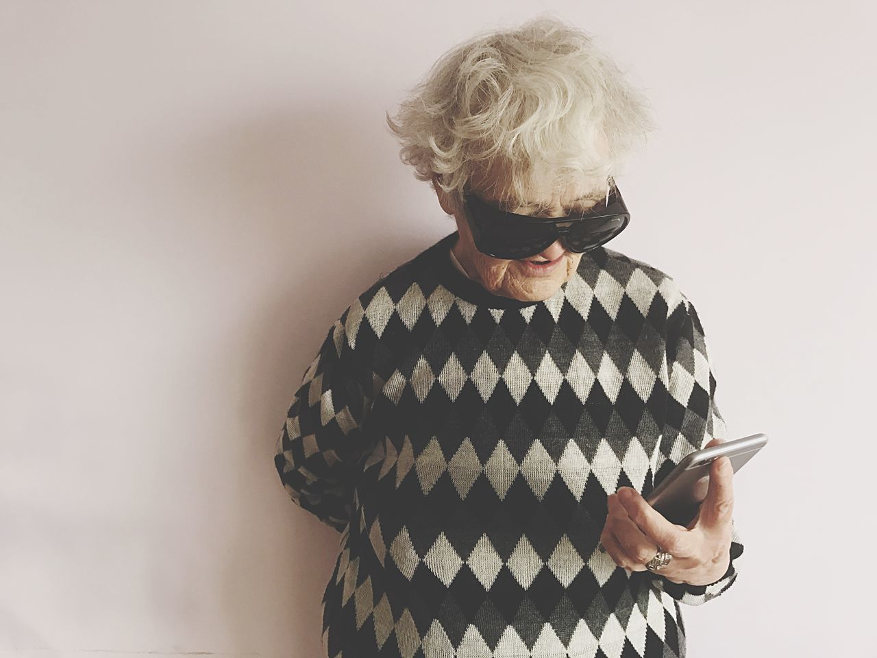 Real People Waist Up Senior Adult One Person Lifestyles Indoors  Front View Standing Leisure Activity Gray Hair Human Hand Old Lady Woman Senior Old Elderly Pensioner New Technology Smartphone IPhone