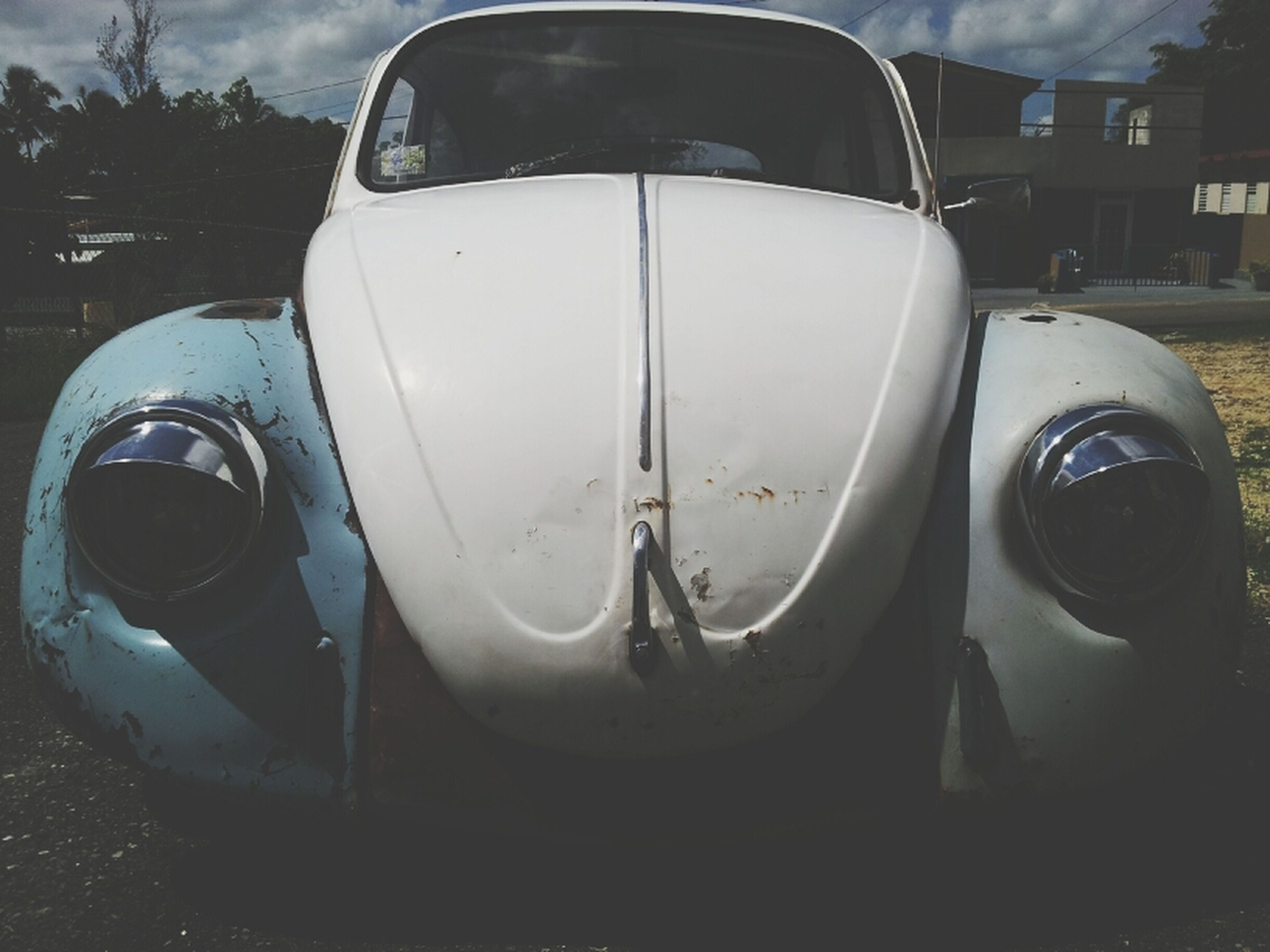 transportation, mode of transport, car, land vehicle, close-up, reflection, side-view mirror, vehicle part, glass - material, no people, stationary, part of, headlight, day, travel, transparent, outdoors, air vehicle, vehicle interior, sky