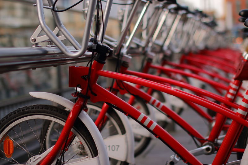 Bicycle Bicycle Rack Close-up In A Row Land Vehicle Let's Go. Together. Metal Mode Of Transport No People Outdoors Red Red On The Move Transportation