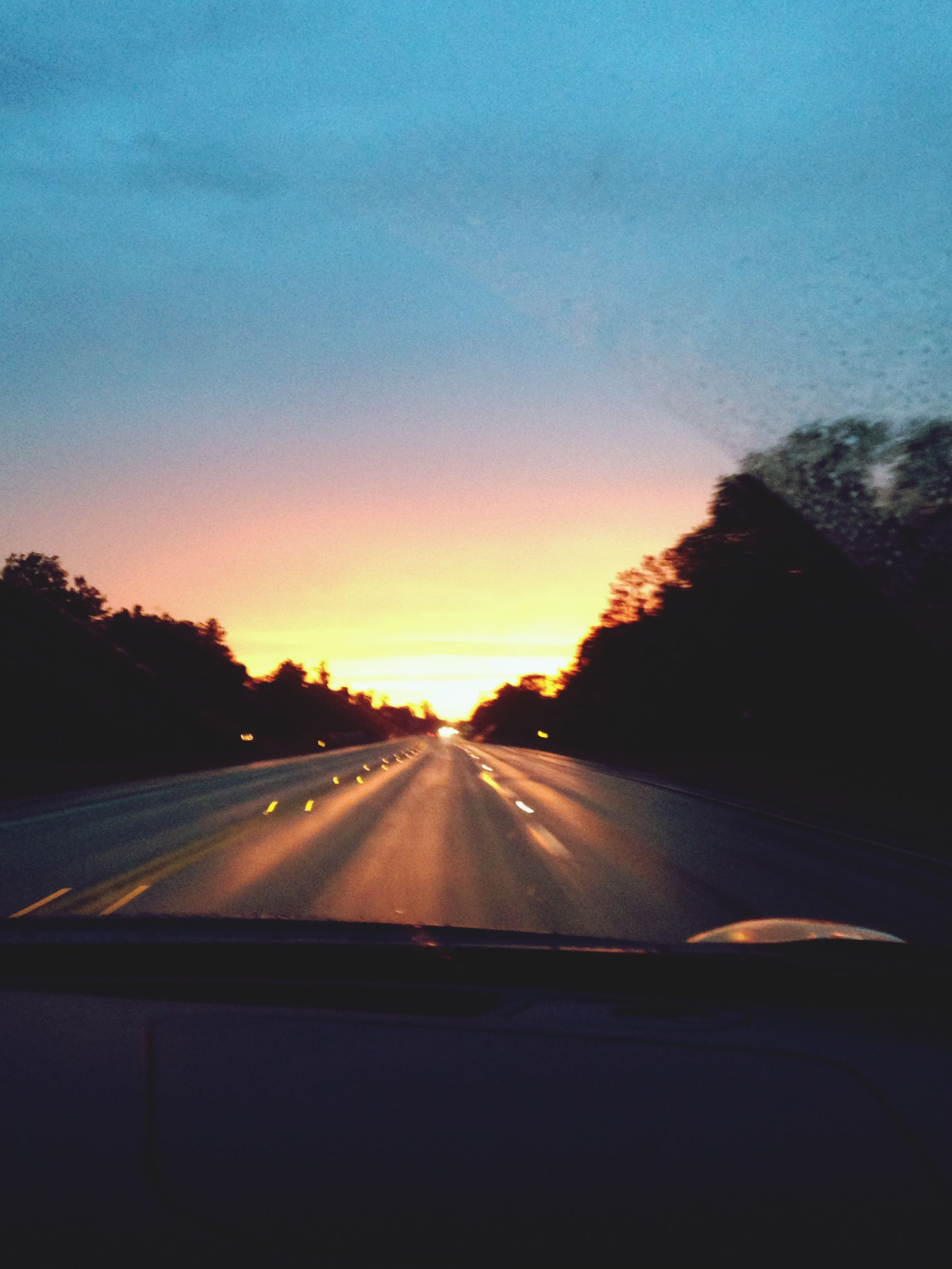 transportation, car, mode of transport, road, windshield, land vehicle, vehicle interior, car interior, glass - material, the way forward, road marking, sunset, transparent, sky, car point of view, tree, diminishing perspective, on the move, travel, road trip