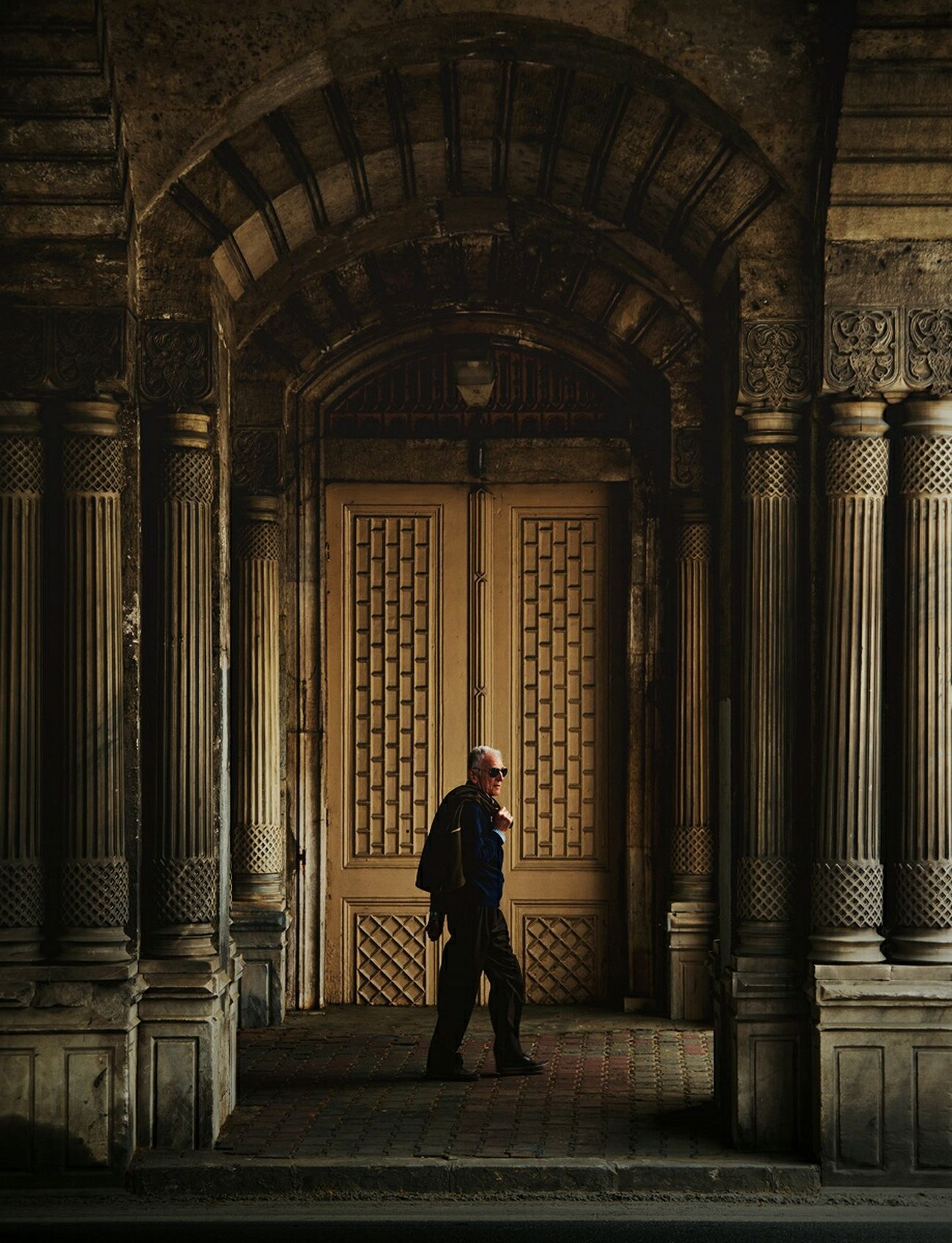 Rear View Architecture One Person Arts Culture And Entertainment People Built Structure Light And Reflection Geometric Shapes Street Life Istanbuldayasam Doorway Streetphotography Outdoors Life Geometric Architecture Building Exterior