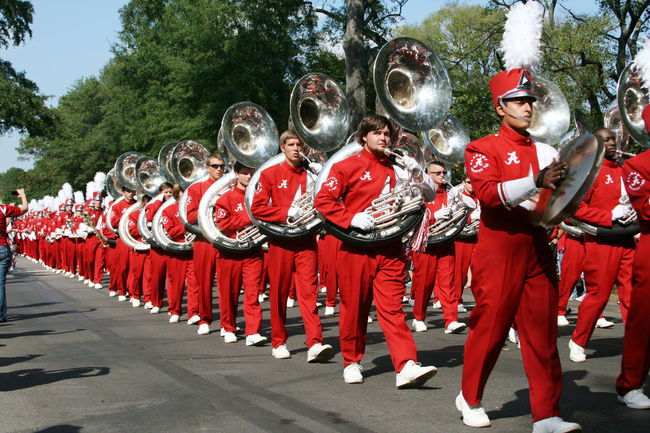 University of Alabama Million Dollar Band parade to the stadium on gameday Bama Crimson Tide  Cymbals Gameday Marching Band Instruments Million Dollar Band Parade Road Tuba Tuscaloosa University Of Alabama The Color Of Sport