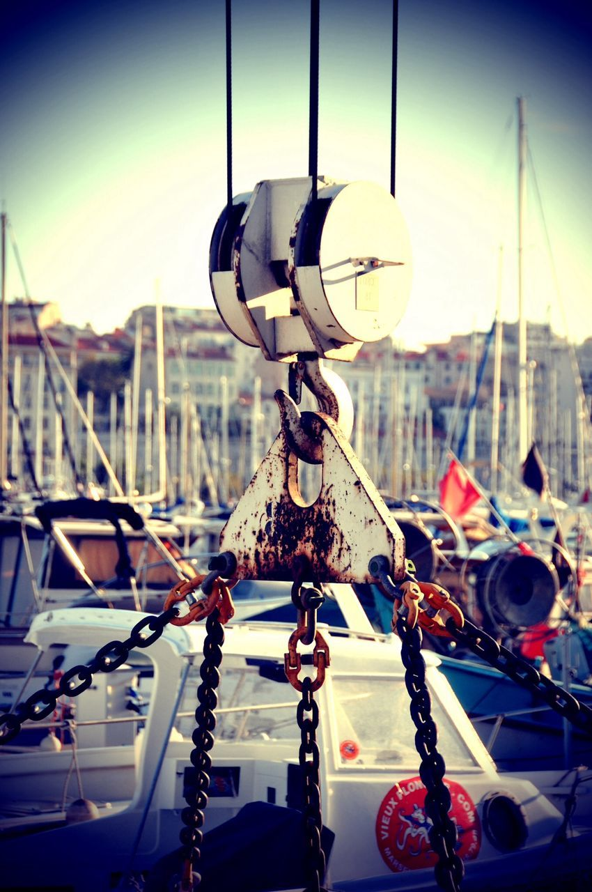 nautical vessel, moored, rope, transportation, mode of transport, hanging, no people, outdoors, focus on foreground, harbor, sunlight, day, close-up, sky