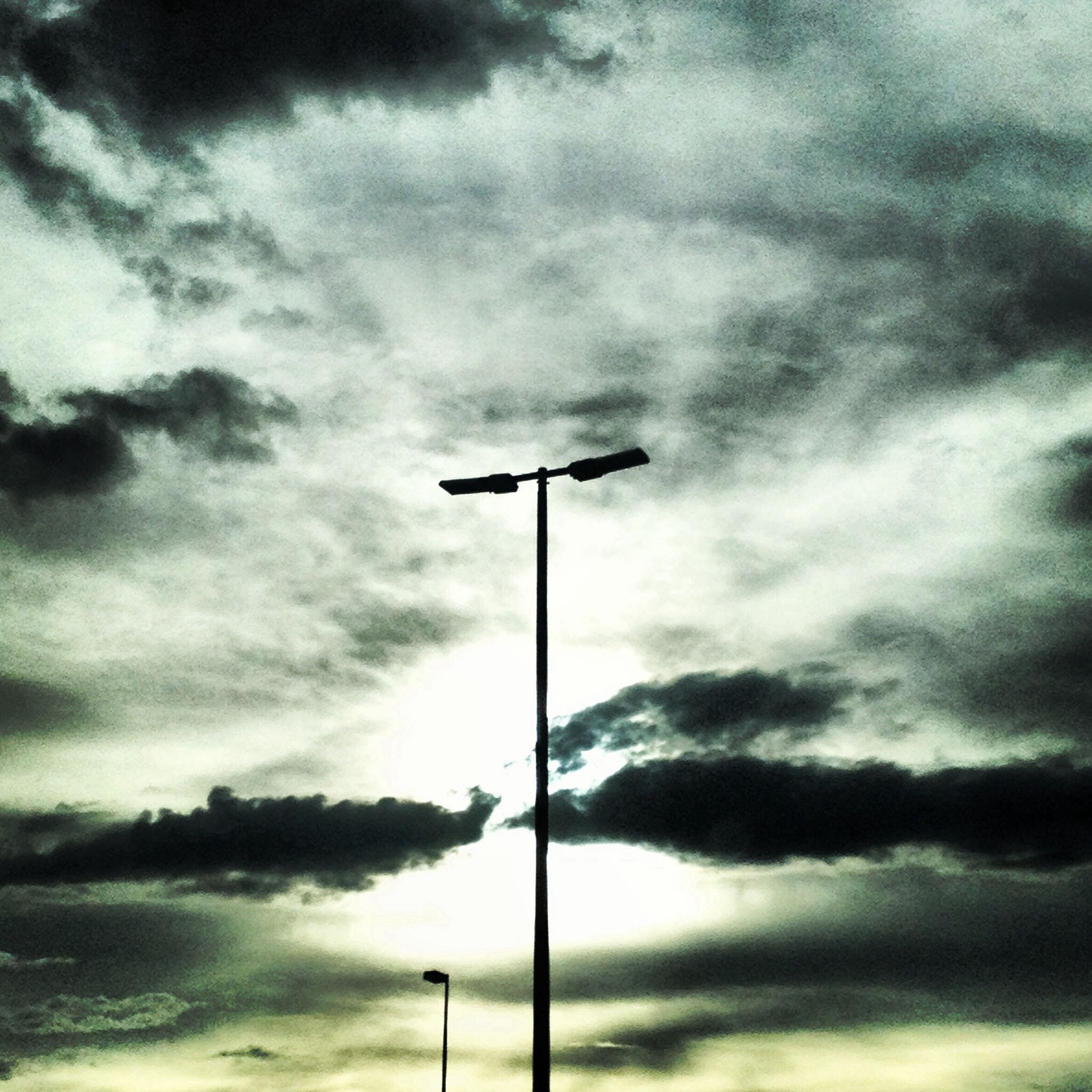 sky, street light, cloud - sky, cloudy, low angle view, weather, lighting equipment, cloud, tranquility, overcast, pole, nature, silhouette, beauty in nature, tranquil scene, scenics, dusk, outdoors, storm cloud, dramatic sky