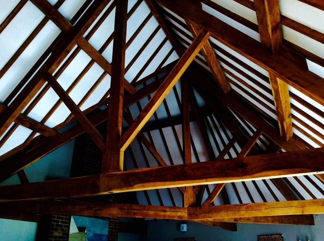 Architecture Low Angle View Pattern Built Structure Wood - Material Day No People Roof Beam Outdoors Sky Ceiling Close-up