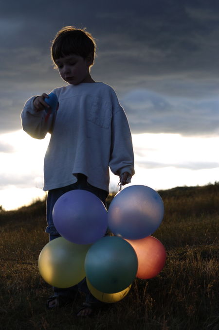 Backlight Balloons Boy Colourful Balloons Contre Jour EyeEmNewHere Pause For Thought Playing Sunset Toys