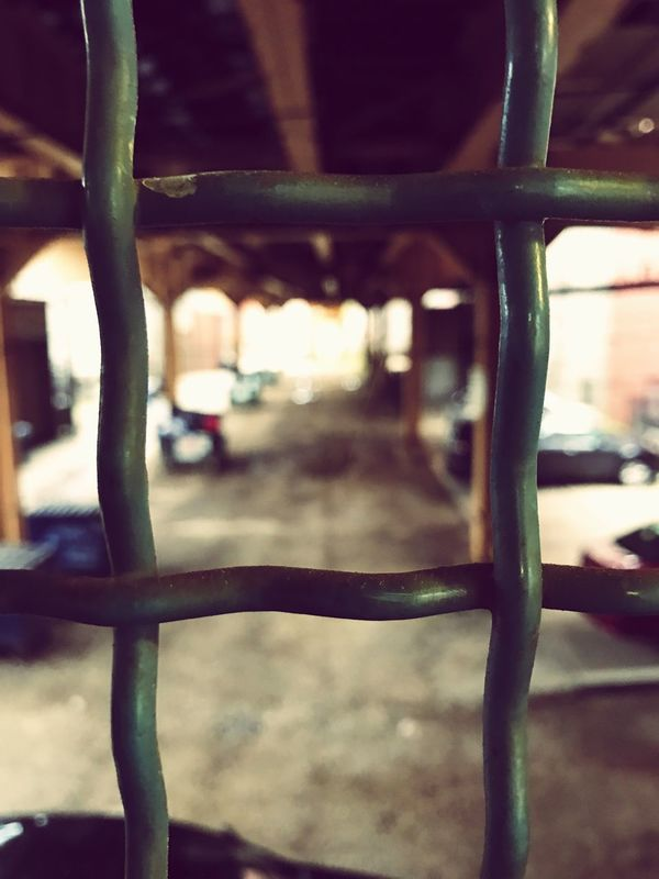 A fence and an alley under the L. Fence Alley Transportation L Train Bokeh Chicago