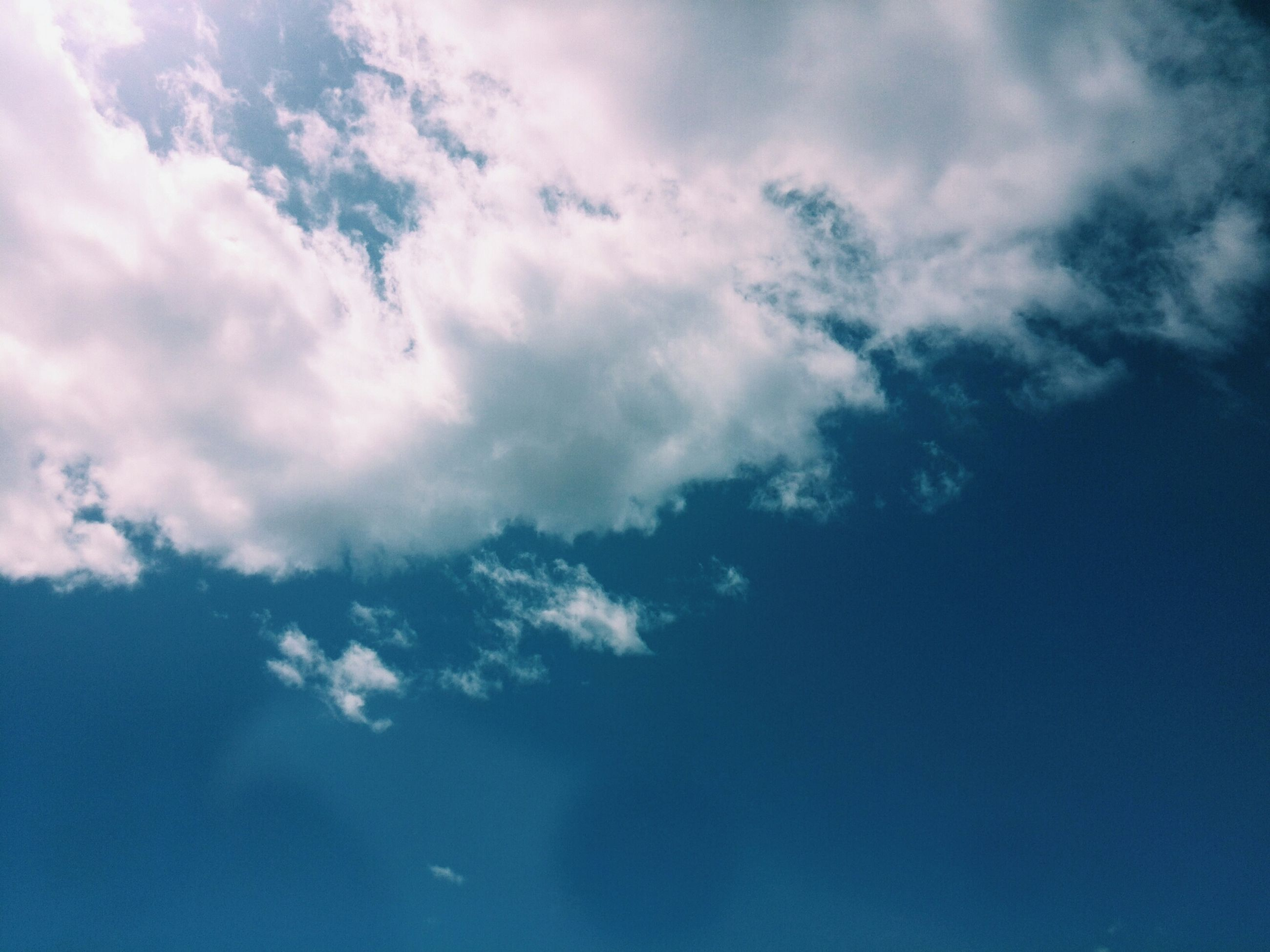 sky, cloud - sky, beauty in nature, low angle view, tranquility, blue, scenics, sky only, nature, tranquil scene, cloudy, backgrounds, cloud, cloudscape, idyllic, full frame, day, outdoors, no people, majestic