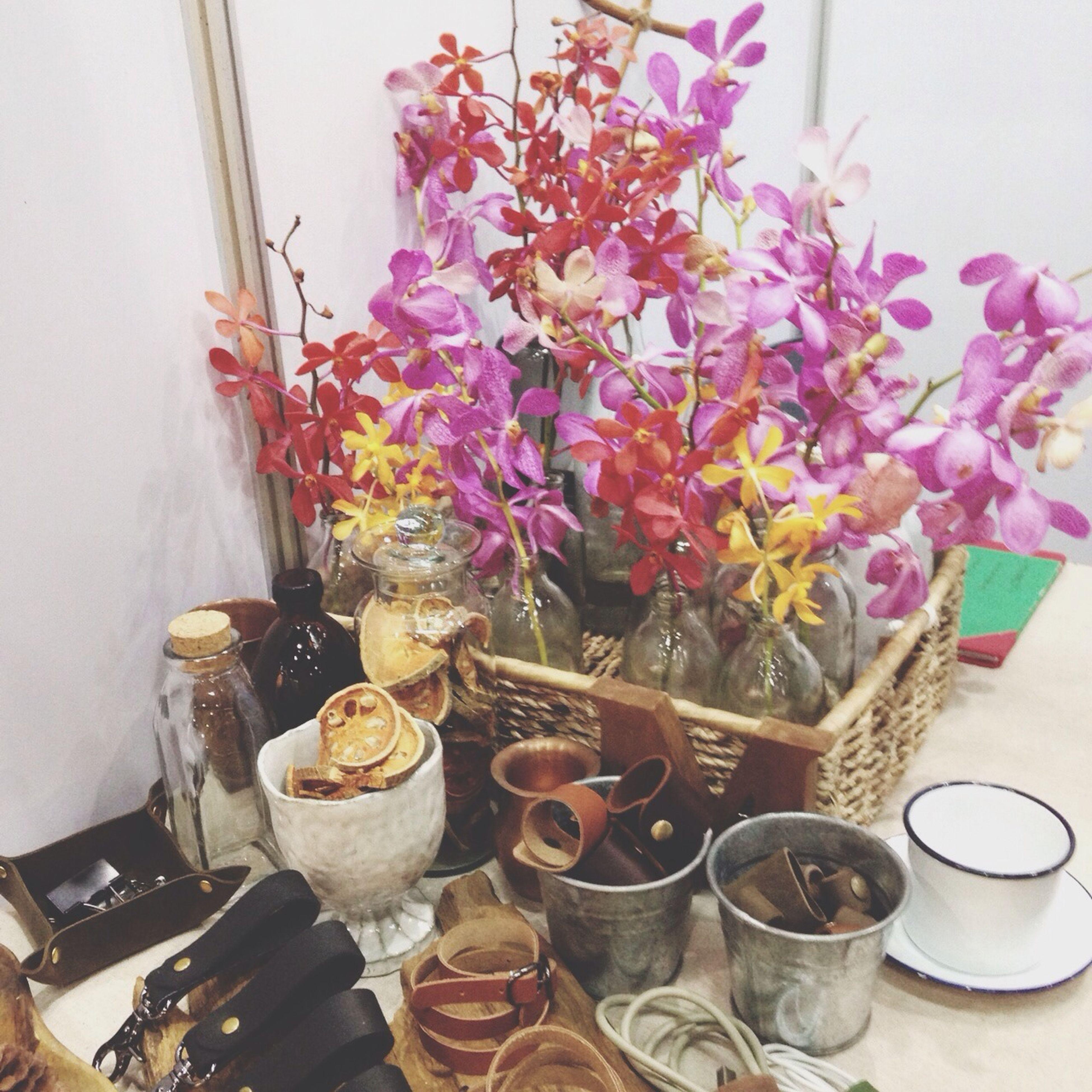flower, indoors, vase, freshness, table, fragility, still life, petal, flower arrangement, potted plant, home interior, decoration, flower pot, close-up, bunch of flowers, glass - material, variation, plant, no people, flower head