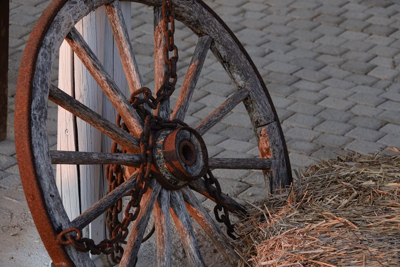 wheel, wagon wheel, damaged, abandoned, old-fashioned, no people, bad condition, wood - material, day, rusty, outdoors, close-up
