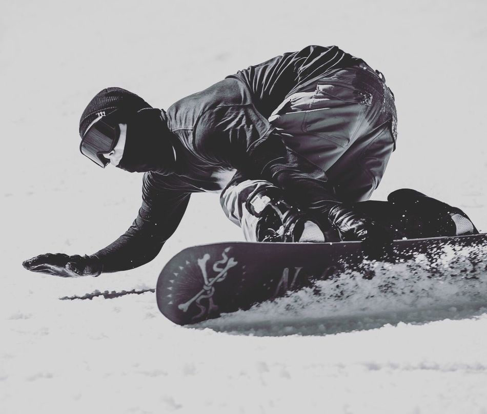 Snow Sports Carving on edge and grabbing rail, Snowboarder Zak Hale loving it on the slopes of Bearmountain California > GoodTimes Snow Mountains