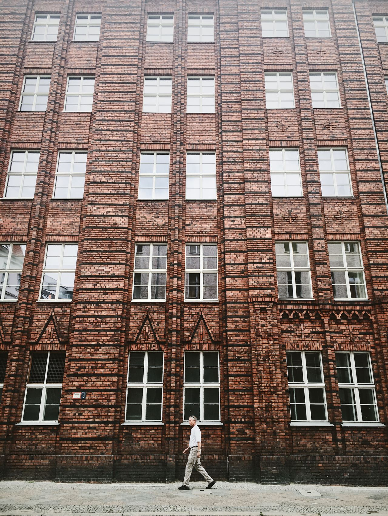 Architecture Berlin Brick Wall City Man Passerby Brick Building Building Exterior Built Structure Daily Life Day Old Buildings One Person People Red Wall Streetphotography Walking Windows