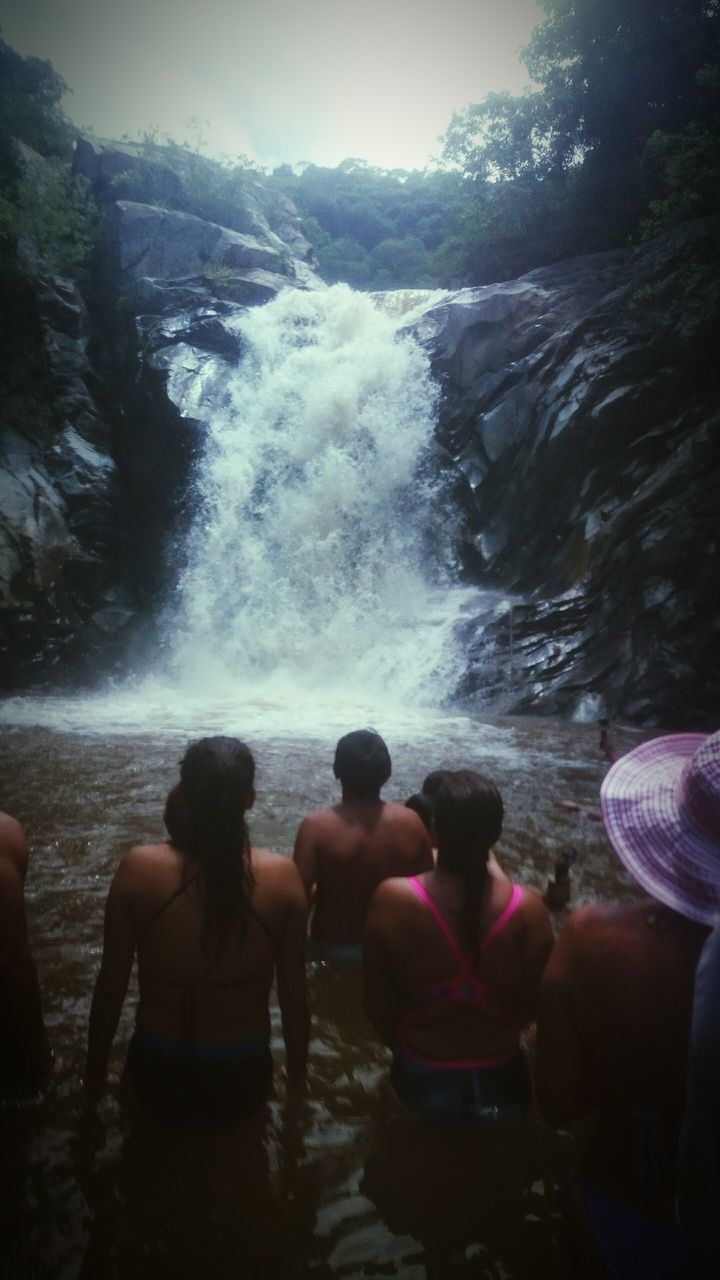 waterfall, long exposure, water, real people, motion, nature, men, lifestyles, outdoors, large group of people, leisure activity, blurred motion, beauty in nature, women, enjoyment, hot spring, vacations, standing, scenics, day, togetherness, power in nature, sky, people