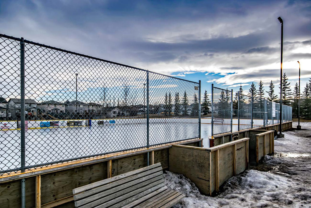 Hidden Valley, Calgary, Alberta, Canada Bridge - Man Made Structure Chainlink Fence Cloud - Sky Day Fence Hockey Hockey Rink No People Outdoors Railing Sky Water