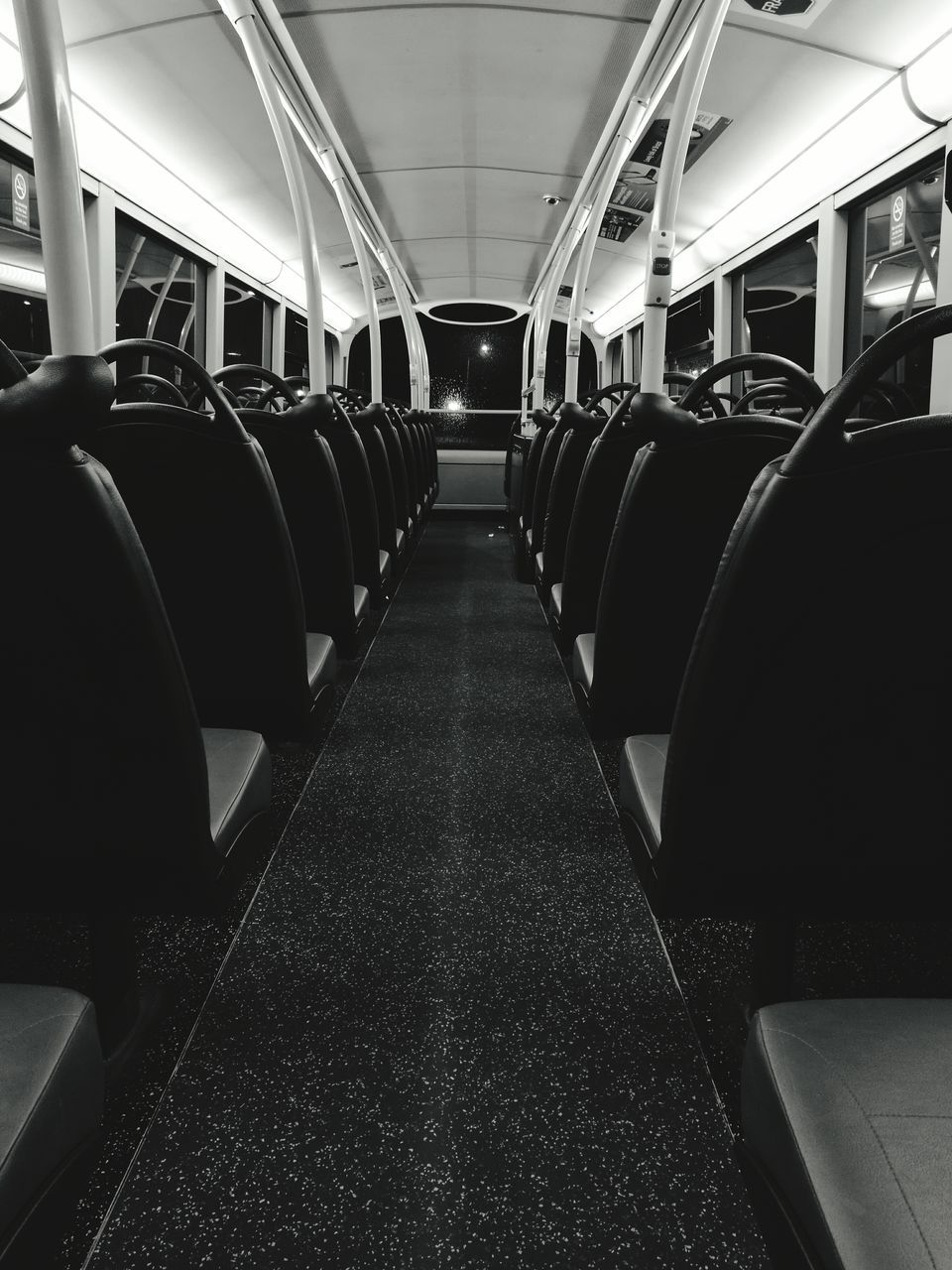 vehicle interior, in a row, transportation, vehicle seat, public transportation, train - vehicle, illuminated, travel, subway train, indoors, mode of transport, rail transportation, no people, commuter train, day