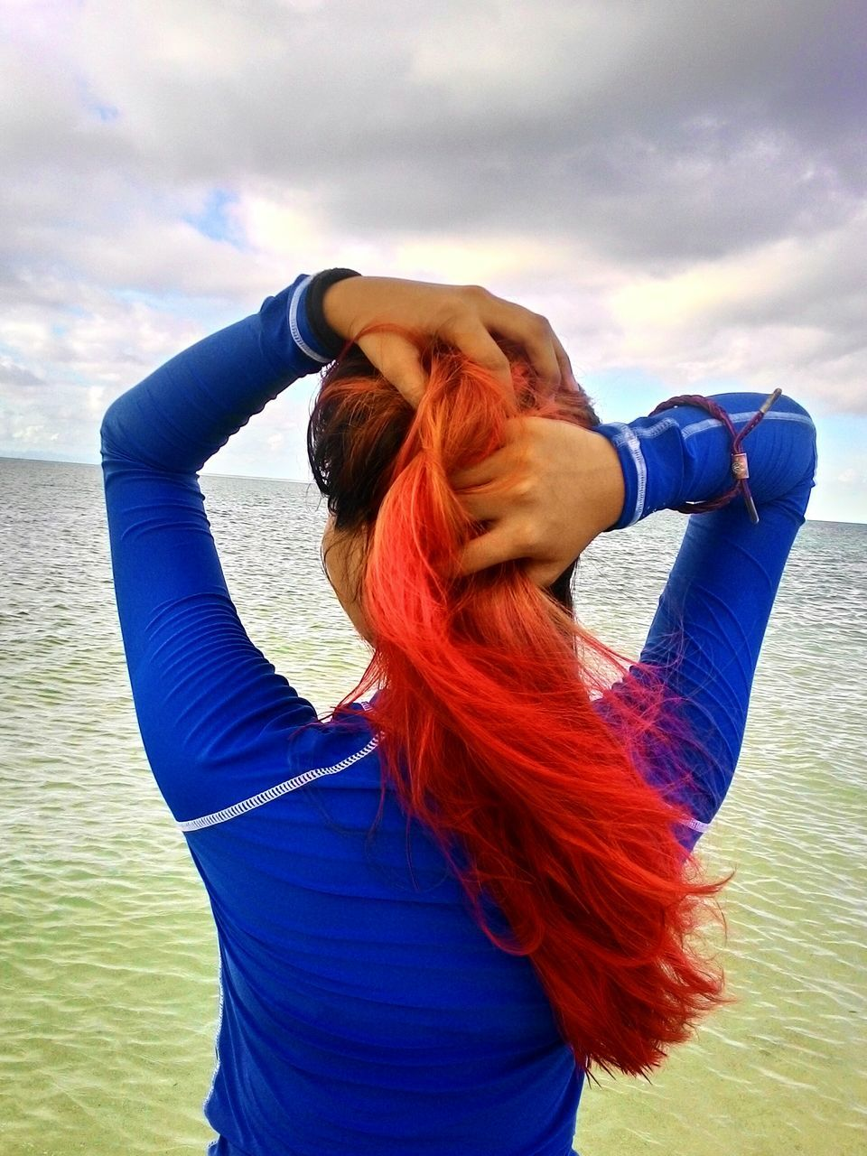 redhead, sea, sky, water, one person, cloud - sky, real people, horizon over water, rear view, dyed hair, standing, leisure activity, outdoors, day, nature, lifestyles, red, beauty in nature, scenics, young adult, young women