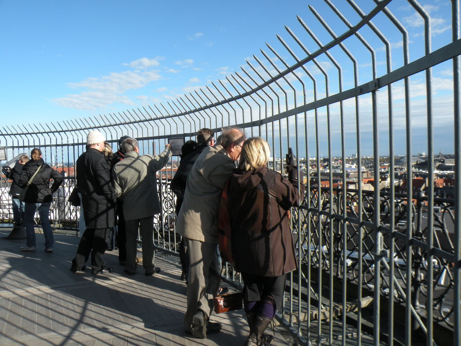 Wiewing platform on top of the Round Tower in Copenhagen on the island of Zealand in Denmark - Sky Large Group Of People Men Leisure Activity Lifestyles Safety Person Fence Casual Clothing City Full Length Togetherness Cloud Outdoors Day Railing City Life Observation Point Sky Men Large Group Of People on the top of the Round Tower in Copenhagen in Denmark